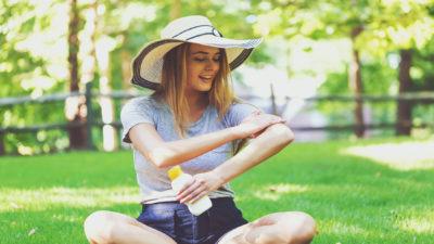 Girl Applying Sun Cream